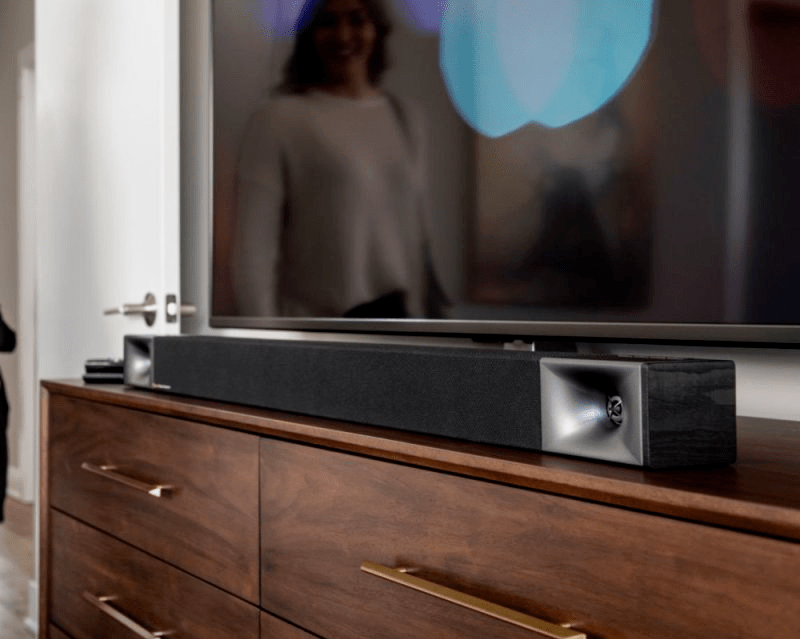 tv and soundbar with reflection of a woman